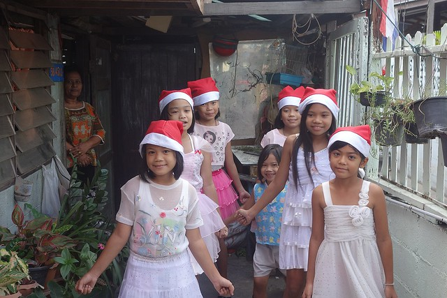 pretty girls singing and dancing a christmas song