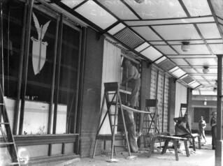 Repairing broken windows at the American canteen (former CCM Building) after the Battle of Brisbane, Brisbane, Nov 1942.
