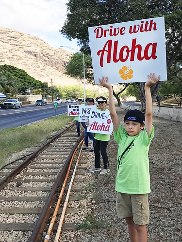 "Hawaiian Electric at the Valley of the Rainbows ""Drive with Aloha"" Sign Waving event — April 11, 2019: Drive with aloha! Set a positive example for our keiki. 