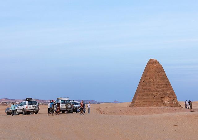Tourists visiting the meroitic pyramids of jebel Barkal, Northern State, Karima, Sudan