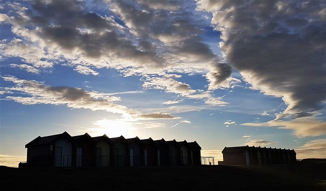 Silhouetted Beach Huts and Cloud Formation
