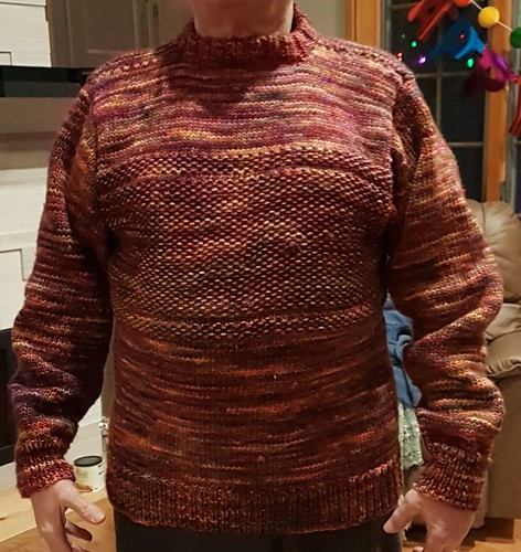"Carol knit this amazing sweater for her husband! Banded Comfy Pullover"" from Bruce Weinstein, and Malabrigo Mecha wool in Archangel and Piedras."