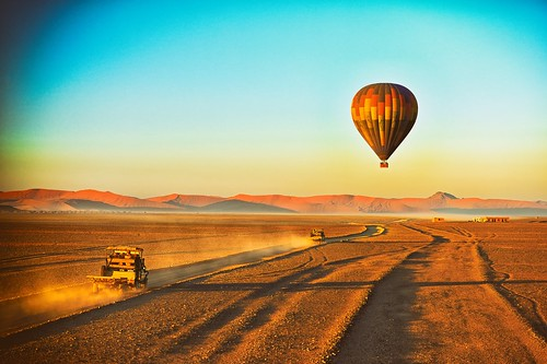 trucks chasevehicles desert flight balloon sossusvlei balloonsafari sunrise dawn hotairballoon littlekulala namibia namibdesert