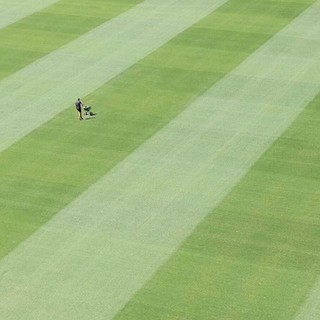 With Cyclone Oma possibly bringing the rains to SE QLD it might be a good time to fertilize 😂😜 I took this shot down at the #MCG while on a tour there. I liked the minimal scene with expanse of grass. The one guy tending t | by Luke KC