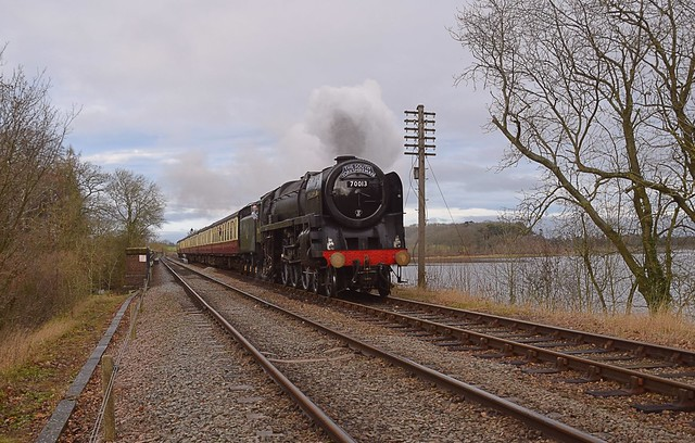 Locomotive 70013 'Oliver Cromwell' passing over Swithland Reservoir, with the 11.00 departure from Loughborough to Leicester North. 30 12 2018