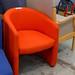 Orange tub chair E110