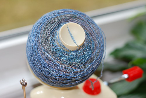 Plastic knitting ball winder with handspun merino/tencel yarn spun by Sarah Jordan and pic by irieknit