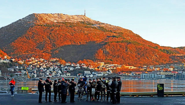 The marching band of the fire department in front of Mt. Ulriken