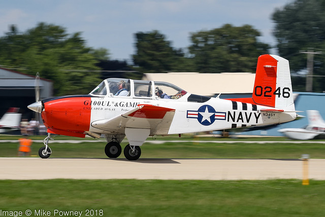 N34SY - 1956 build Beech T-34B (D45) Mentor, departing from Runway 27 at Oshkosh during Airventure 2018