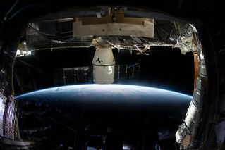The SpaceX Dragon above Quebec   by NASA Johnson