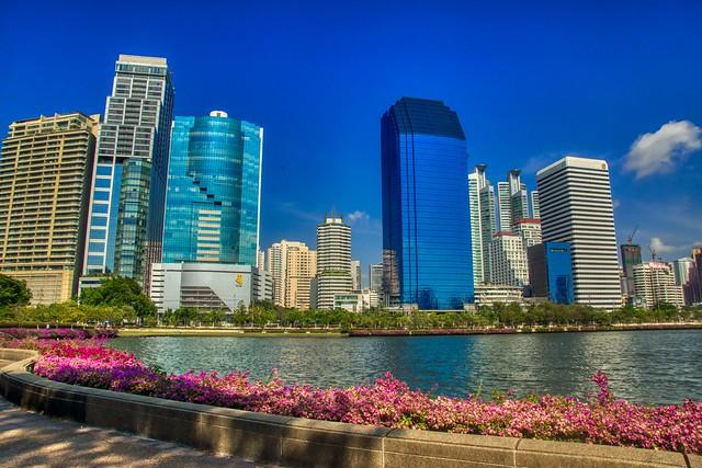 Benjakiti park and lake with skyline in Bangkok, Thailand