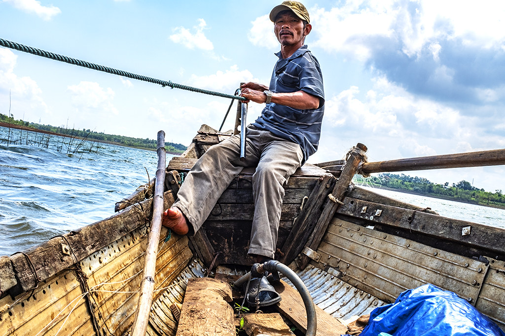 Fisherman on his boat--Krong Buk