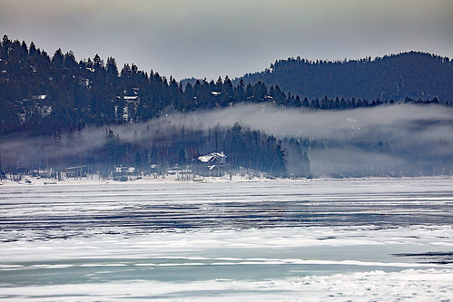 montana whitefish whitefishlake citybeach lowclouds clouds ice winter trees slopes mountain houses shoreline feburary snow wyojones