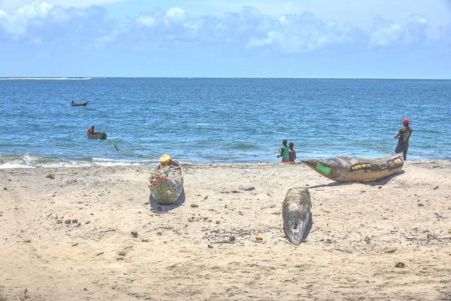Fishermen,boats and net.