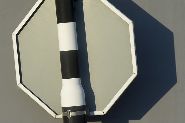 Pole, sign and shadow