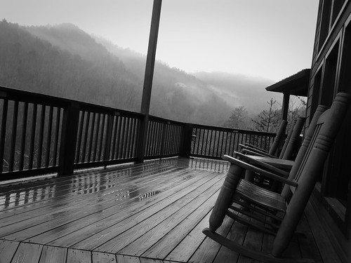 cabin deck view mountains smokies bw blackandwhite black white noir blanc monochrome rain rainy downpour flooding rockers rockingchairs railing pines trees p1000 coolpixp1000 nikoncoolpixp1000 jennypansing fog mist foggy misty clouds cloudy