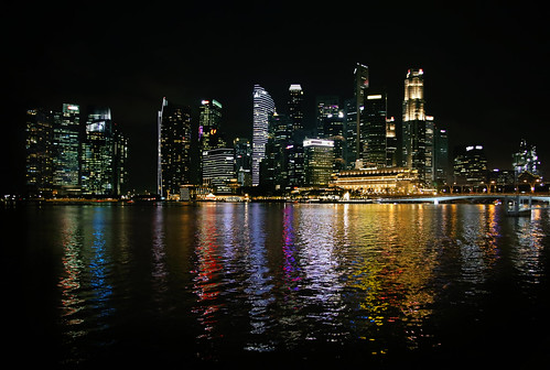 Singapore skyline at night and city reflections | by B℮n