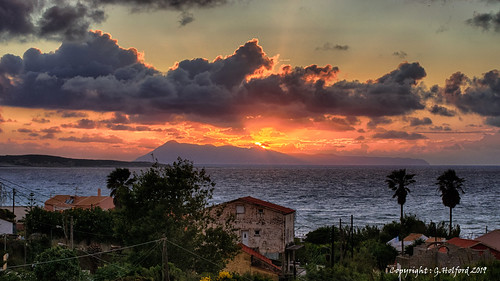2017 corfu greece spring sunset nikon d5300 clouds spectacular favourite place lovely glorious sunsetview sunsetlight lovelysunset trees dwelling coastal holiday seaview oceanview stunning greekview edge lastglimpse memories remember paradise favouriteplace perfect glowing setting