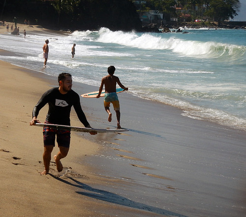 Surfing the high waves caused by the full moon in Puerto Vallarta, Mexico