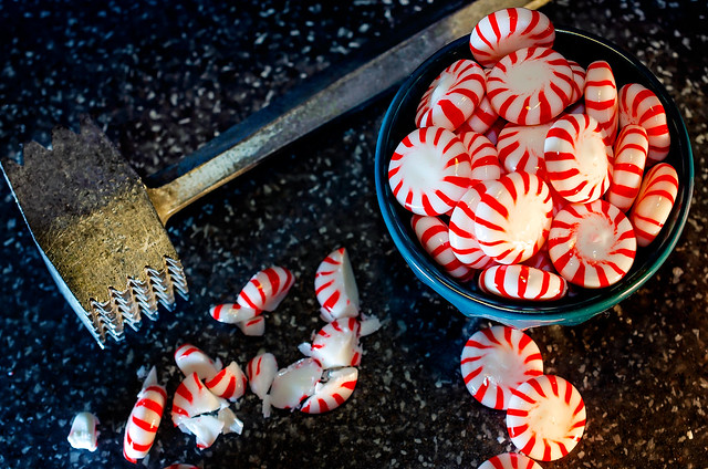 Crushed peppermint candy pieces with vintage meat tenderizer mallet