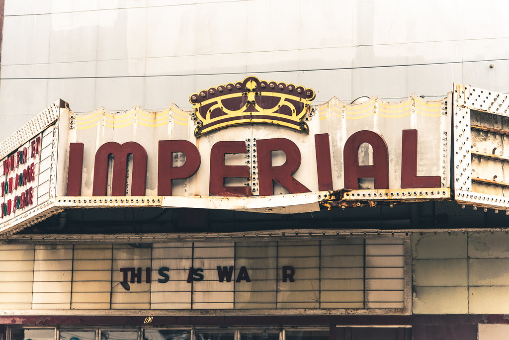 "An abandoned theater marquee.  It reads: ""This is war"""