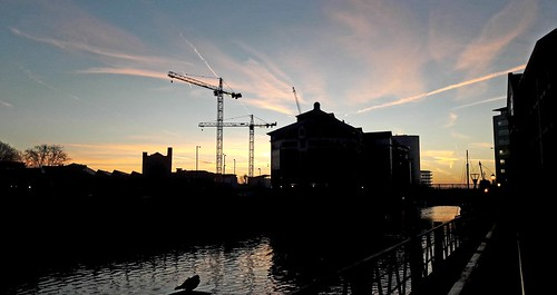 bristol water river sky blue red yellow buildings cranes structure national home outside nature light art sun clouds sunrise landscape city bridge bird trails old new reflecting reflected