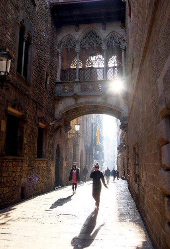 people bridge light barcelona shadow sunrise buildings catalunya spain street architecture arch city urban