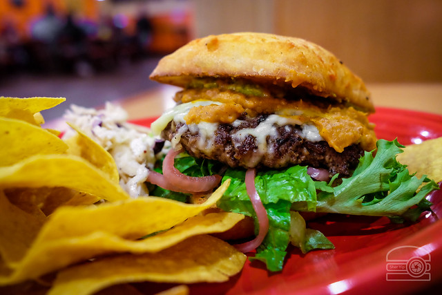 'Lada Love Burger - house enchilada sauce, fresh greens, pickled onions, avocado slices, Sriracha refried beans - Black Bear Burritos Evansdale