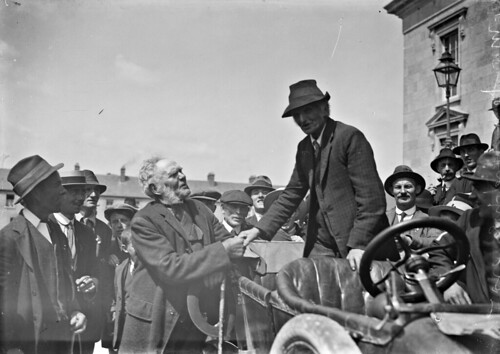 brendankeogh thekeoghphotographiccollection keoghbrothersltd nationallibraryofireland electionrally motorcar handshake muttonchops people ennis countyclare enniscourthouse courthouse pressingtheflesh politics politician
