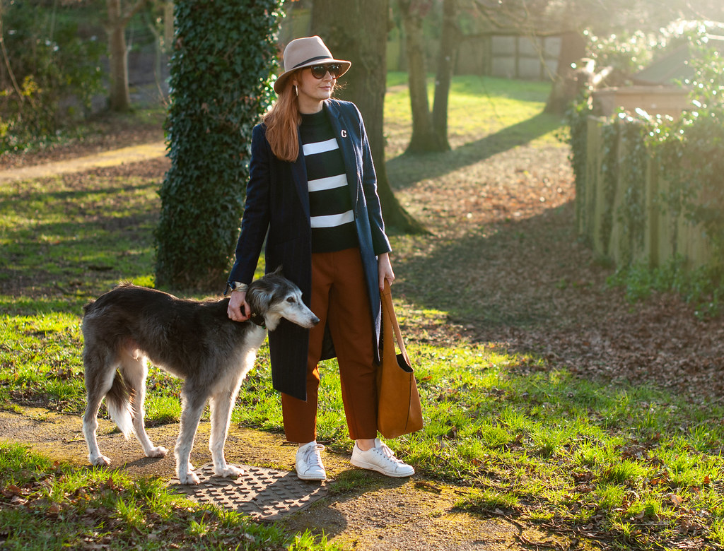 How to Wear Workwear and Sportswear Together (long pinstripe navy coat, Breton stripe sweater, pumpkin trousers, Stan Smiths) | Not Dressed As Lamb, fashion over 40