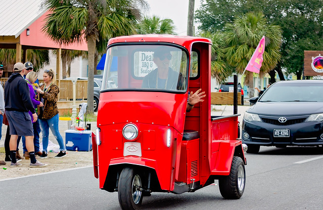 Vintage Cushman Truckster at Krewe de la Dauphin Mardi Gras parade in Dauphin Island, Alabama