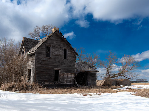 blue abandoned farmhouse spring sky canada house manitoba bales snow
