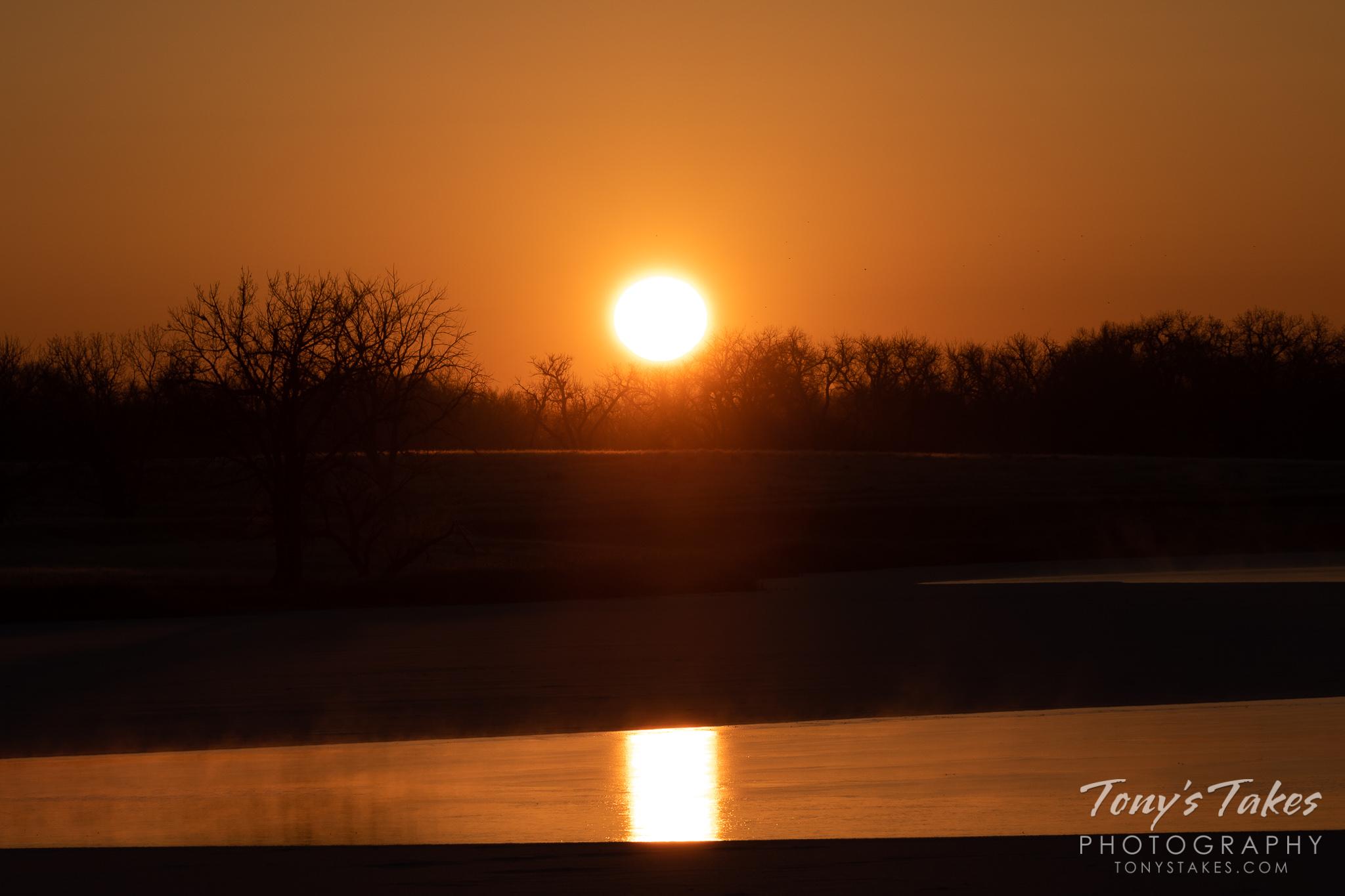 Orange globe begins to cast its warming light