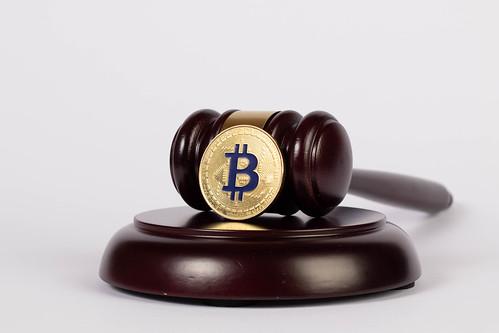 Golden Bitcoin with judge hammer   by wuestenigel