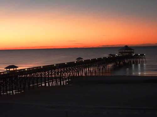 sunrise pier follybeach follybeachpier charleston sc southcarolina charlestonsouthcarolina dawn rosy pink red horizon still structure geometric reflections p1000 coolpixp1000 nikoncoolpixp1000 jennypansing