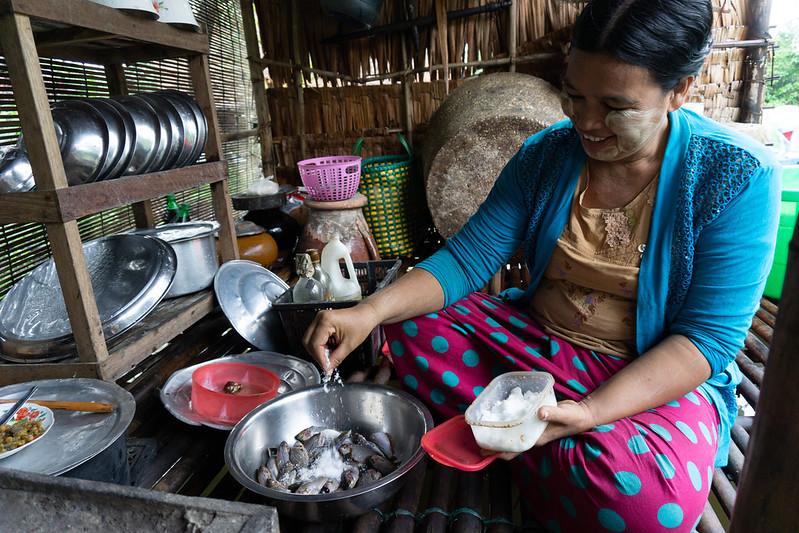Daw Cho Mar preparing fish for breakfast.