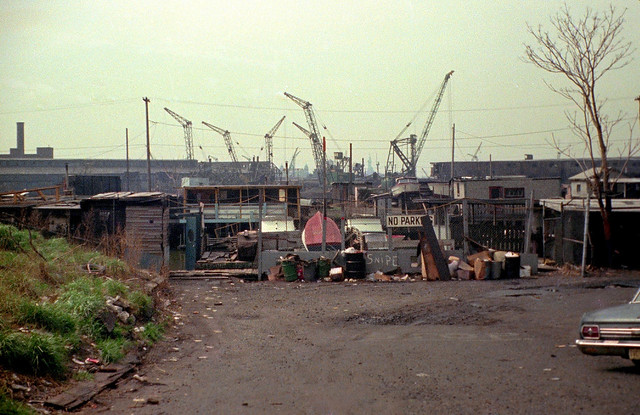 Hiroshima after the atomic bomb decimated the city? Well, not really. The same look without radioactivity at the end of Greene Street by the bank of the Morris Canal toward the Statue of Liberty and Ellis Island in the distance. Jersey City. March 1975