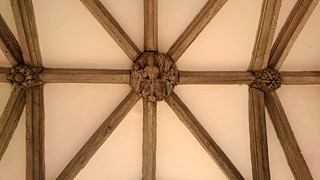 porch bosses: Holy Trinity flanked by Tudor rose and foliage (15th Century)