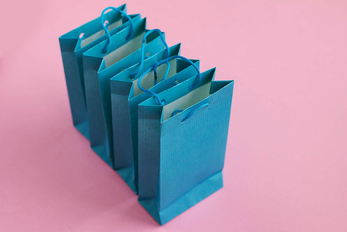 Group of blue gift bags on pink background. | by wuestenigel