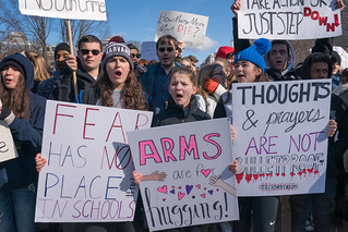 Arms are for hugging, students participating in National Walkout Day marching to the Capitol on Pennsylvania Ave, Washington DC | by Lorie Shaull