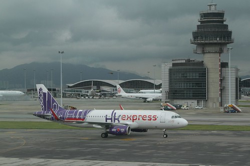 HK Express Airbus A320-232 B-LCC taxis to the gate