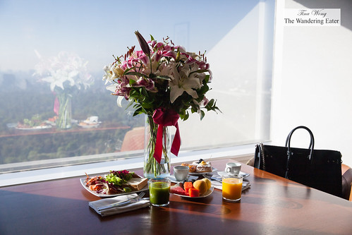 Fresh lilies and snacks at my suite room with a view | by thewanderingeater