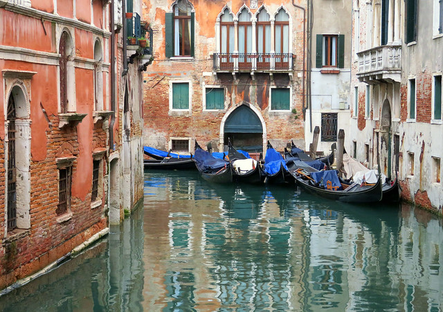 Gondolas in a canal in Venice, Italy