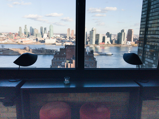 View of Long Island City and chic interior