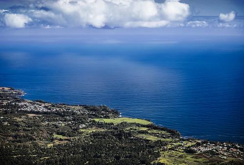 hawaii hilo paukaapoint paukaa house homes beach sand waves pacificocean sea clouds helicopter blue wyojones np