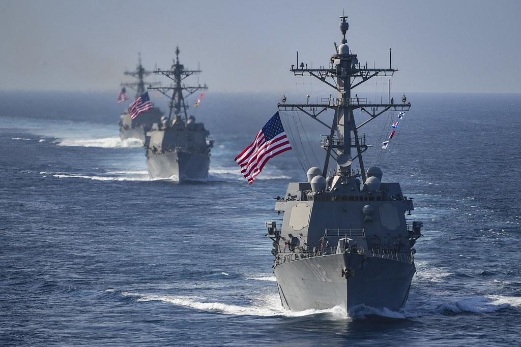Navy destroyers are underway in the Arabian Gulf.