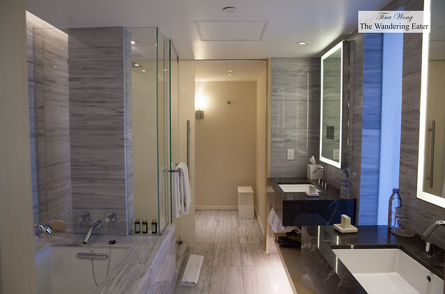Spacious bathroom with dual sinks, standing shower and soaking tub