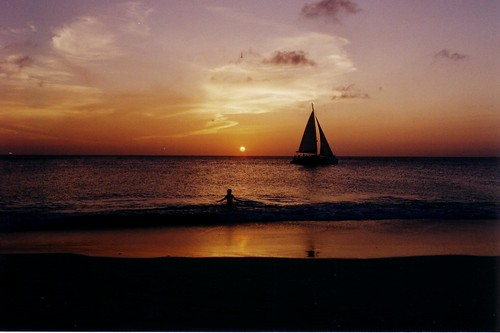 Boat, person in Aruba sunset