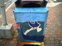 Delightful Creature On Trash Can