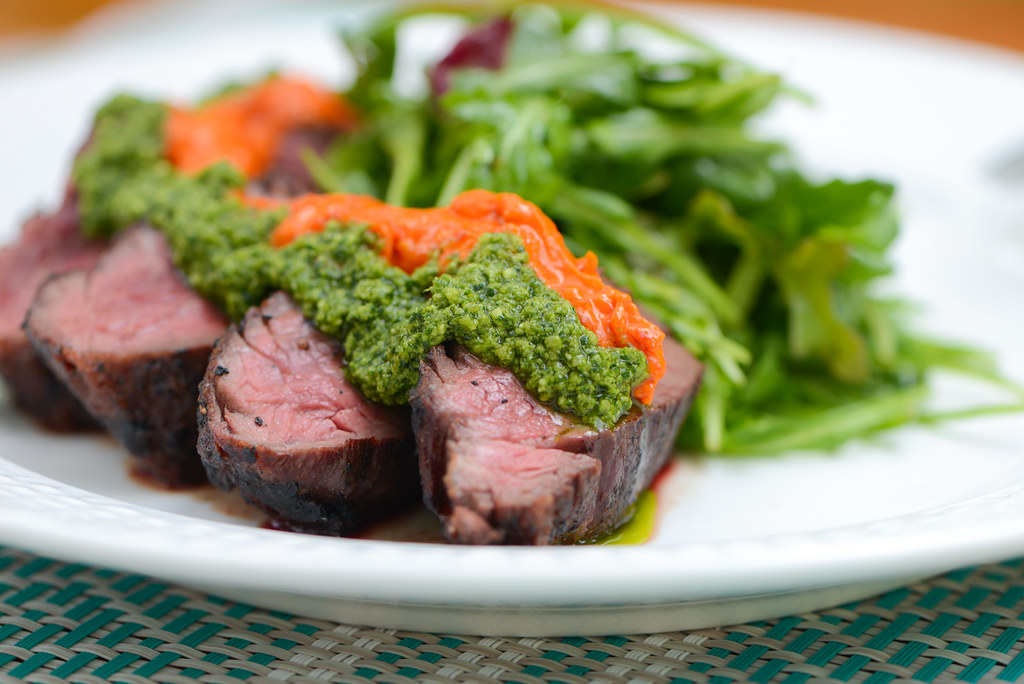 Grilled Hanger Steak with Harissa Butter and Cilantro Pesto